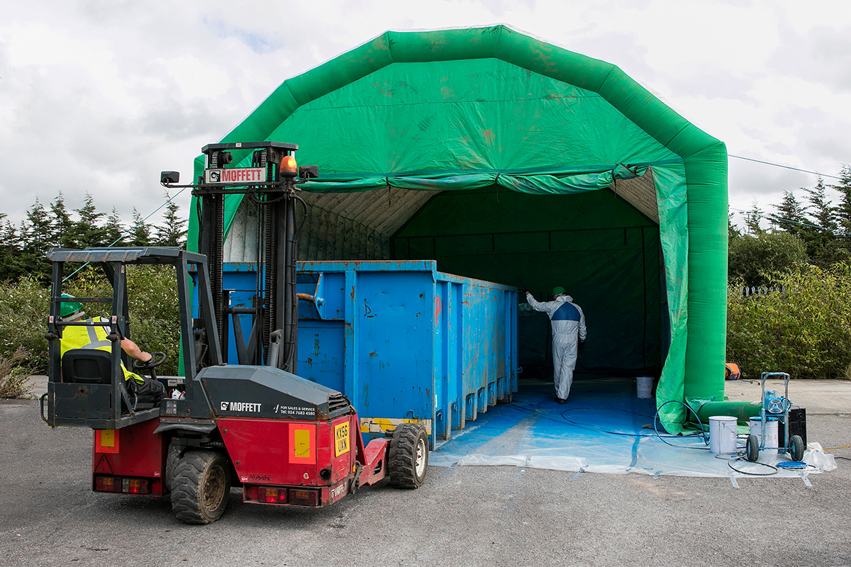 Rough Terrain Forklift Maneuvering Bulk Into Tent